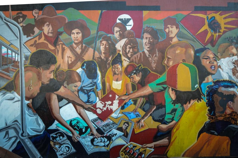 Murale che rappresenta un incontro di un gruppo di attivisti. Si possono riconoscere alcuni personaggi come...