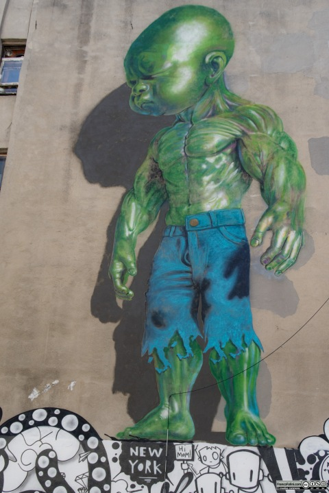 Green Baby Hulk mural by Ron English on the wall of Mulberry Street Little Italy Manhattan New York USA