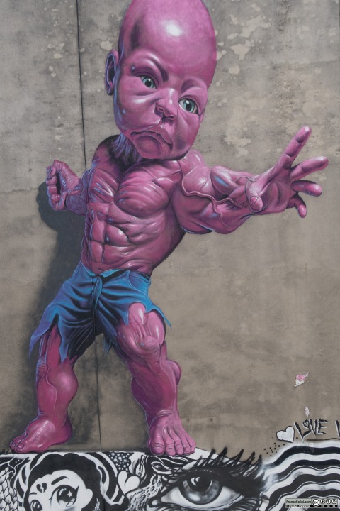 Pink Baby Hulk mural by Ron English on the wall of Mulberry Street Little Italy Manhattan New York USA