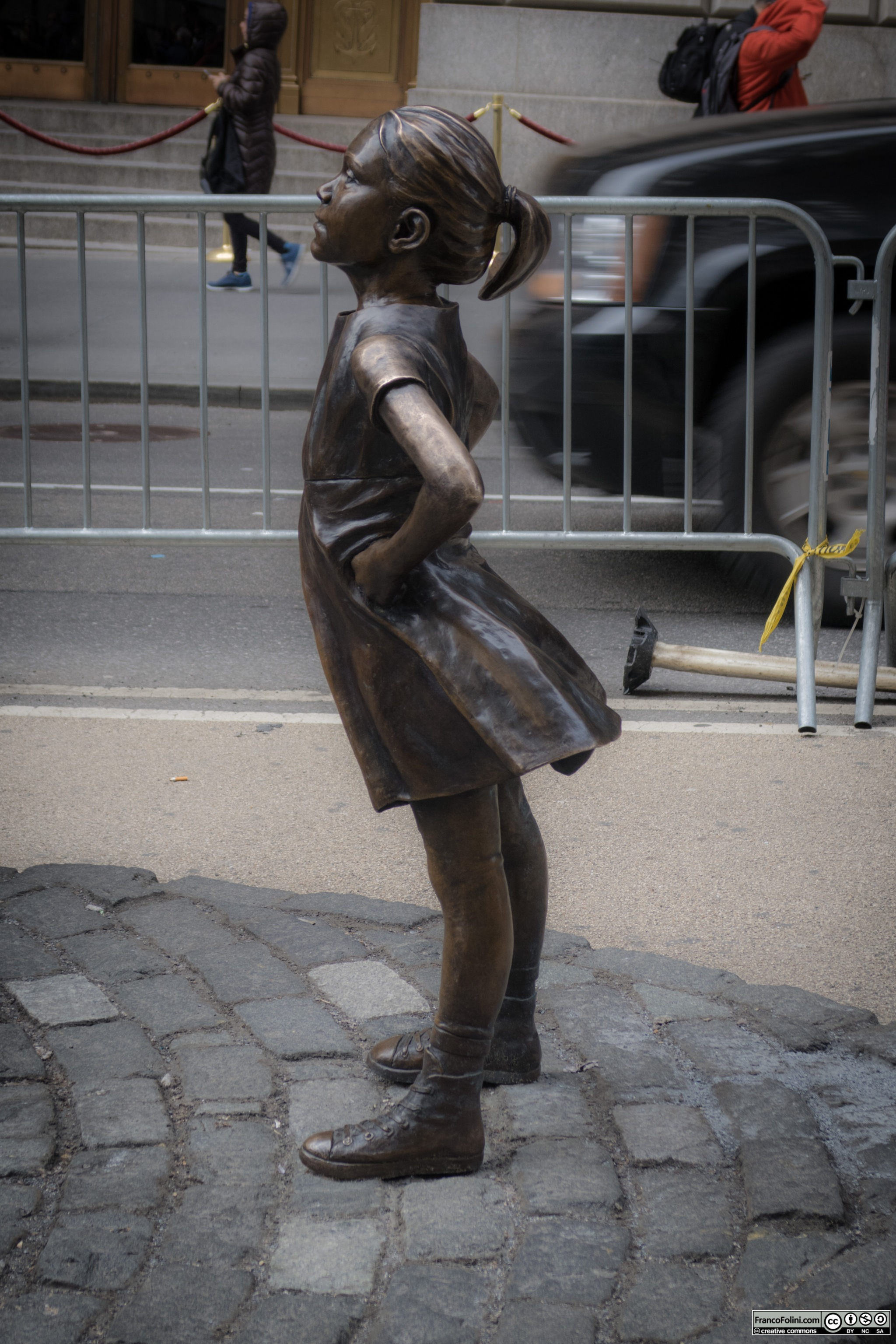 """Fearless Girl"" bronze sculpture by Kristen Visbal facing the ""Charging Bull"" bronze sculpture by Italian-American sculptor Arturo Di Modica, Wall Street, Manhattan, NYC"