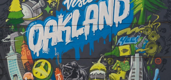 """Visit Oakland"" by Illuminaries mural on facade of the Oakland Marriott City Center, Oakland, CA"