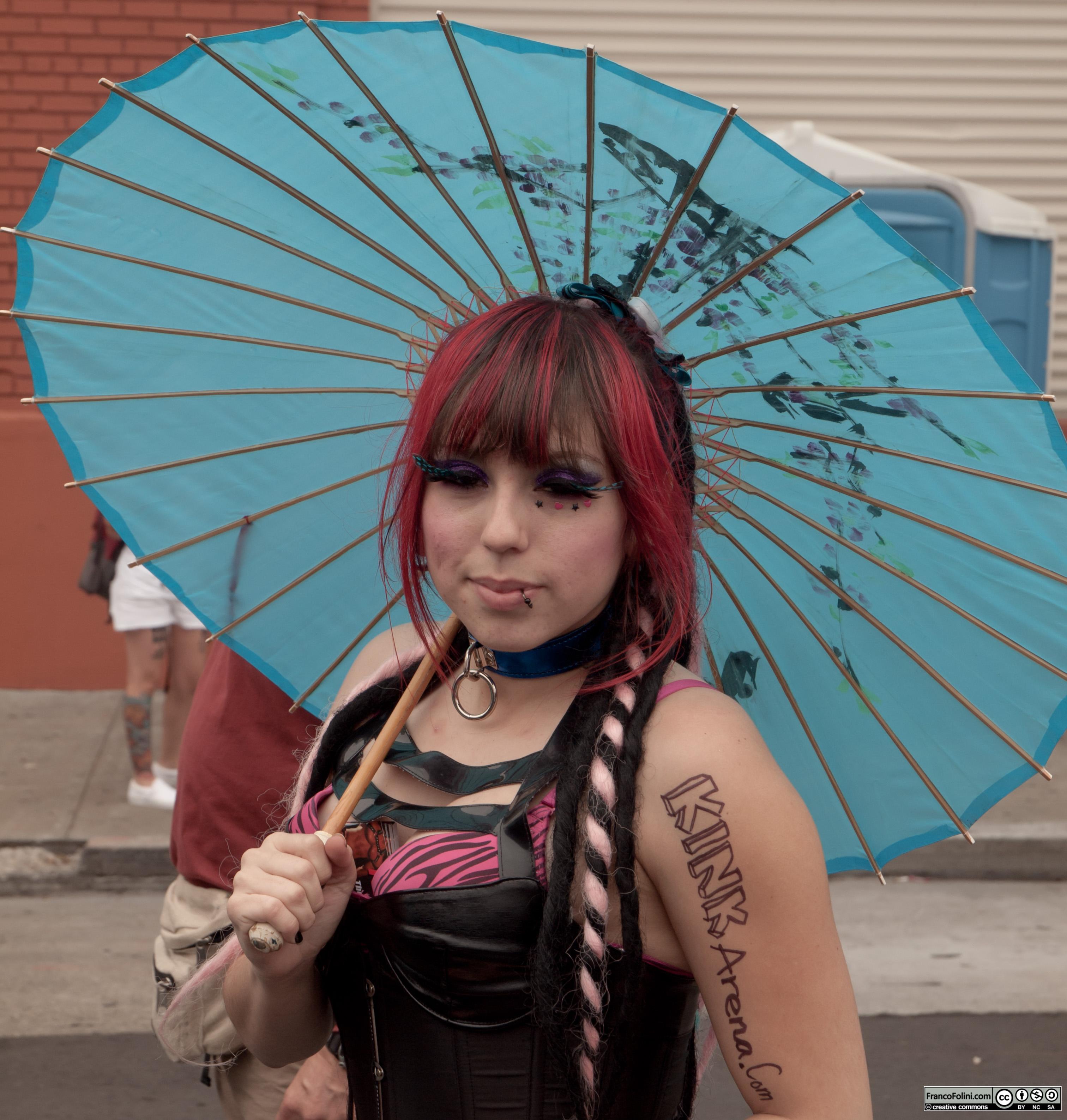 San Francisco Folsom Street Fair: girl with umbrella