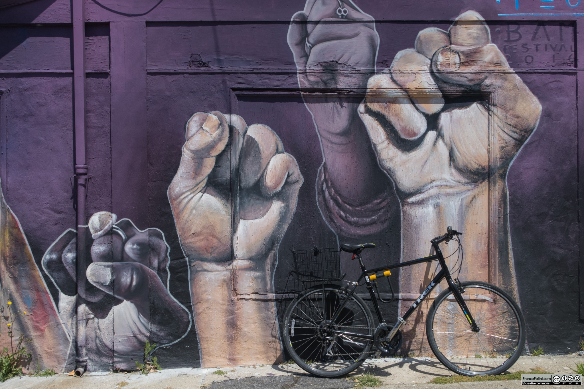 Bike and mural (mural by Chilean muralist Teo Doro) in Berkeley, CA