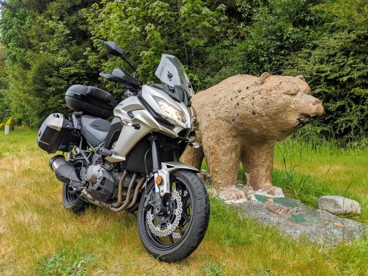 A golden bear marks the entrance of the Klamath Village inside the Indian Reservation near the estuary of the Klamath River. Kawasaki Versys 1000 LT