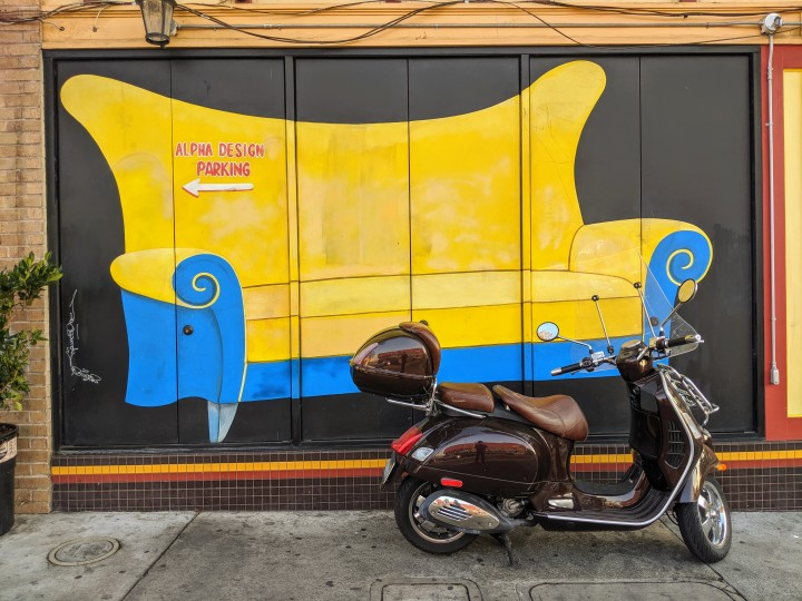 University Avenue, Berkeley: mural with a couch on the walls of a furniture shop, Alpha Design.